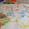 Abstract art for kids with paint, water and straws