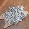 Crocheting with magazine paper yarn