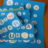 Improving literacy in bilingual children: iPhone apps and homemade board games